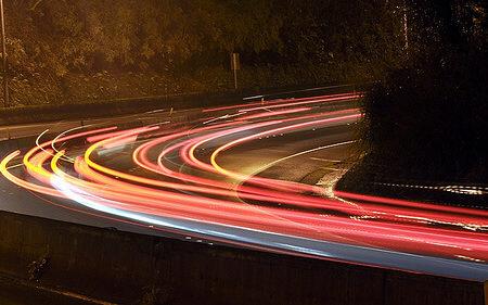 car head lights going round a corner
