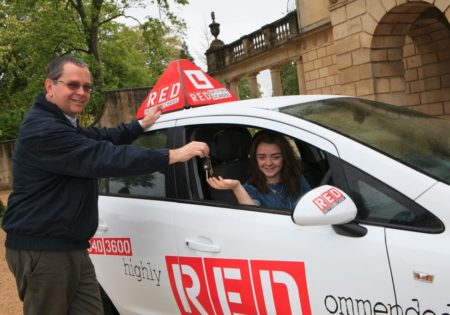 Dave Childs handing car keys to Maisie Williams