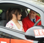 Learner and instructor in car