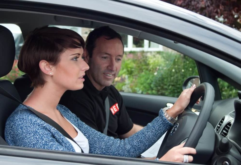 RED instructor and learner in car