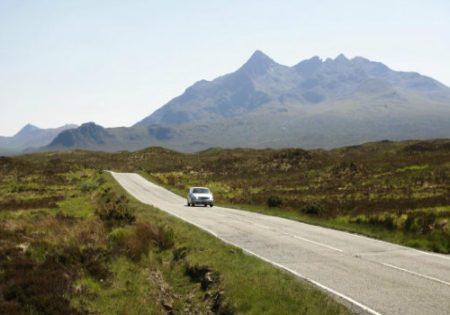 car driving in the scottish highlands