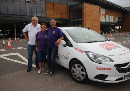 Thanet Lions infront of white RED car