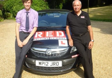 Tiff Needell and Harry leaning on RED car bonnet