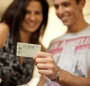 man holding provisional licence with woman