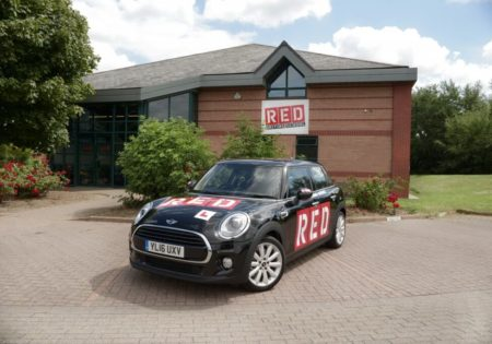 RED black mini parked outside red driving school