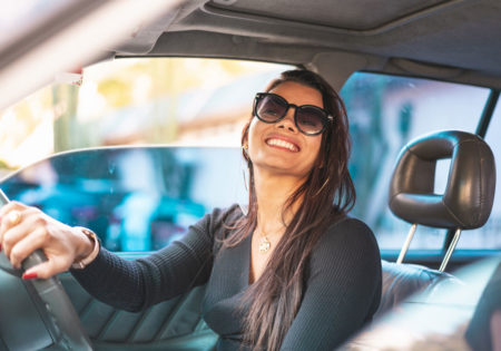 Woman smiling in driver seat