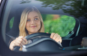 Woman smiling while driving