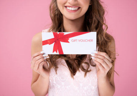 woman holding gift voucher