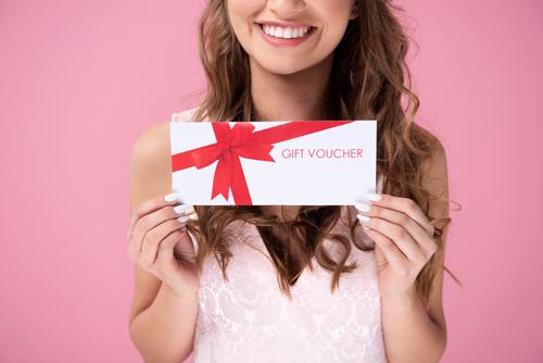 woman holding gift voucher
