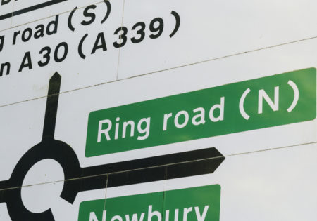 Road sign showing directions to Ring Road from a roundabout