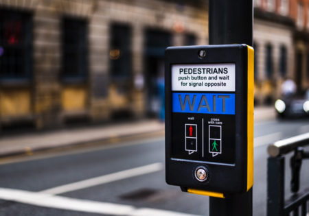 Yellow and black pedestrian crossing button