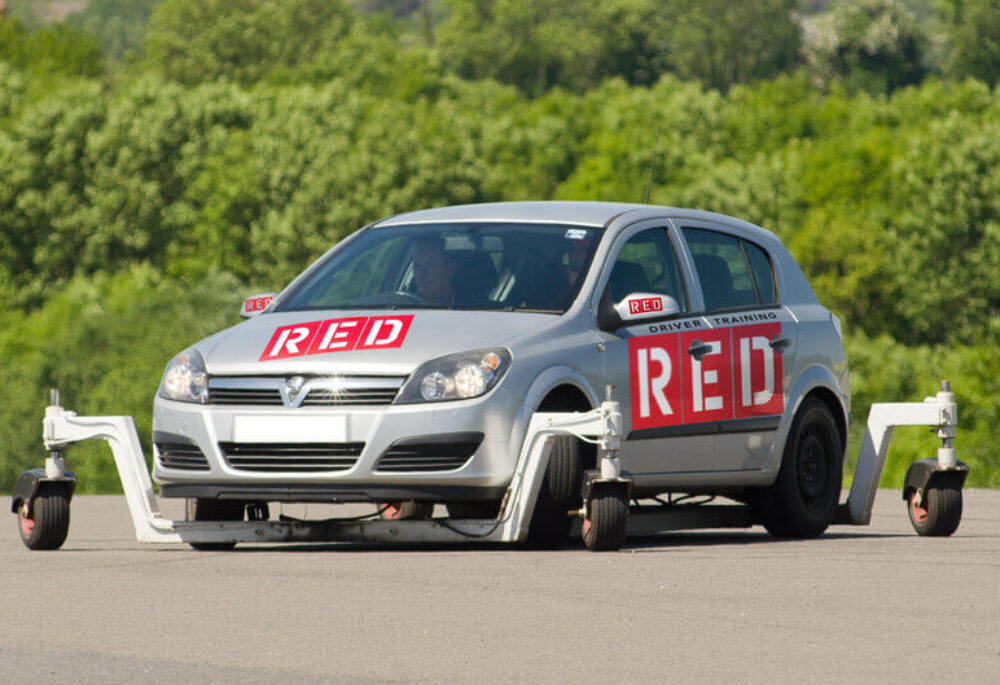 RED driving school skid car