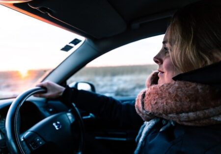 woman in scarf driving