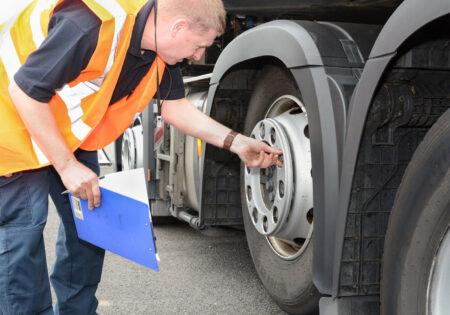 man checking lorry types