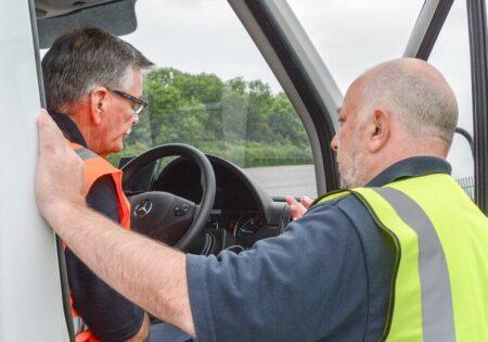 two men talking in a lorry