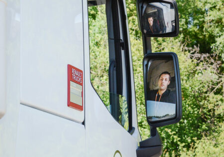 man looking in lorry mirror