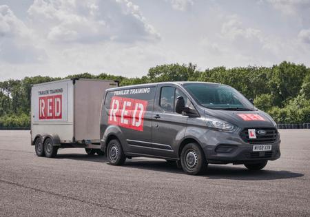 RED van towing trailer